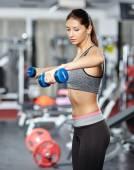 Girl doing deltoid workout — Stock Photo