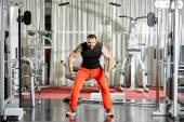 Workout at cable machine — Stock Photo