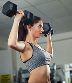 Shoulder workout with dumbbell — Stock Photo