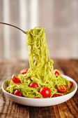 Pasta recipe with avocado and tomatoes — Stock Photo