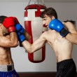 Kickbox fighters sparring in the gym — Stock Photo #63392329
