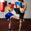 Kickbox fighters sparring in the gym — Stock Photo #63392385