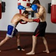 Kickbox fighters sparring in the gym — Stock Photo #63392413