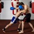 Kickbox fighters sparring in the gym — Stock Photo #63392415