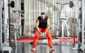 Triceps workout at cable machine — Stock Photo