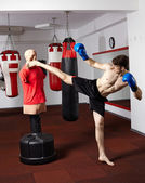 Kickboxer training in the gym — Stock Photo