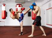 Kickbox fighters sparring in the gym — Stock Photo