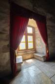 Castle window with curtains — Stock Photo