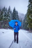 Man in the forest on wintertime — Stock Photo