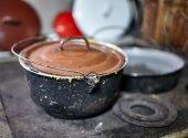 Polenta pot on ironcast stove — Stock Photo