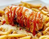 Cordon bleau with fried potatoes — Stock Photo