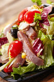 Green and red salad with tuna — Stock Photo