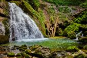 Waterfall and river in canyon — Stock Photo