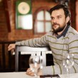 Young man in a restaurant — Stock Photo #69488121