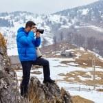 Tourist taking pictures to the mountains — Stock Photo #69488777