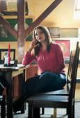 Sad woman in a restaurant — Stock Photo