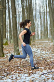 Young lady trail running — Stock Photo