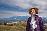Happy woman on the mountains — Stock Photo