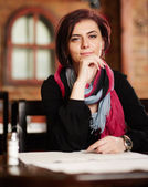 Young beautiful woman in a restaurant — Stock Photo