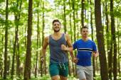 Friends running through forest — Stock Photo