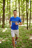 Fit runner on a trail run — Stock Photo