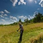 Young farmer mowing the lawn — Fotografia Stock  #77717952