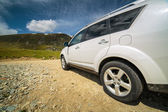 Car at the bottom of a mountain — Stock Photo