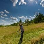 Young farmer mowing the lawn — Fotografia Stock  #79205310