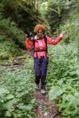 Hiker with photo camera walking — Stock Photo