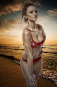Woman in bathing suit on the beach — Stock Photo