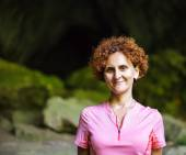 Woman standing at a cave entrance — Stock Photo