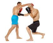 Kickboxers sparring on white — Stock Photo