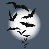 Halloween background - flying bats in full moon — Stock Vector