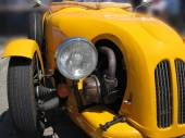 Front of a yellow old timer — Stock Photo