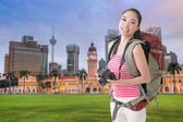 Backpacker with camera — Stock Photo