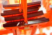 Votive tablets made of the shape of orange torii.   — Stock Photo
