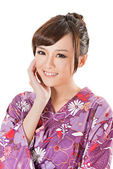 Smiling Japanese beauty in traditional clothes — Stock Photo