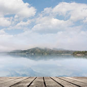 Lake with mist and cloud — Stock Photo