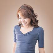 Shy Asian girl smiling — Stock Photo