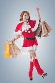 Asian Christmas girl hold shopping bags — Stock Photo