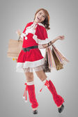 Asian Christmas girl hold shopping bags — Stock Photo