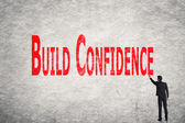 Write words on wall, Build Confidence — Stock Photo