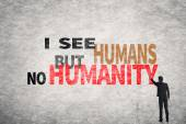 Text on wall, I See Humans But No Humanity — Stock Photo