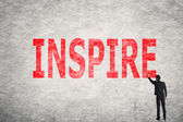 Text on wall, Inspire — Stock Photo