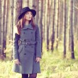 Portrait of young beautiful woman in autumn coat — Stock Photo