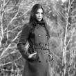 Portrait of young beautiful woman in autumn coat — Stock Photo #69363205
