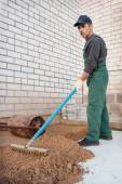 Leveling the ground before laying paving stones — Stock Photo
