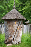 Ancient old wooden beehive — Stock Photo
