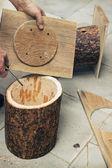 Carpenter closes the cover birdhouse — Stock Photo