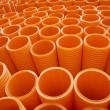 Large Group of Orange Industrial Plastic Pipes Full Frame — Stock Photo #69382659